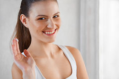 Skincare. Portrait of a Beautiful Smiling Woman With Cream on He Stock Photo