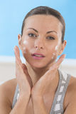 Skincare products - Beautiful women applying moisturizer Stock Photos