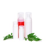Skincare products with green fern leaves Royalty Free Stock Photo