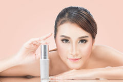 Skincare products, Portrait of Beautiful Young Woman looking at. Camera. Beautiful Asian female model on pink background with clipping path Royalty Free Stock Photography