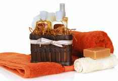 Skincare products with towels and soap. Luxurious skin and haircare products with soft towels and soap stock photos