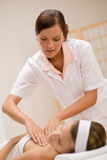 Skincare - woman cleavage massage at salon Stock Images