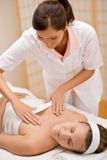Skincare - woman cleavage massage at salon Stock Image