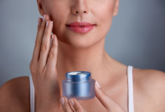 Skincare. Woman taking care of her dry complexion, concept skincare royalty free stock photos