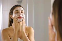 Free Skincare Woman Washing Face  Foaming Soap Scrubbing Skin. Face Wash Exfoliation Scrub Soap Woman Washing Scrubbing With Skincare Stock Images - 168157904