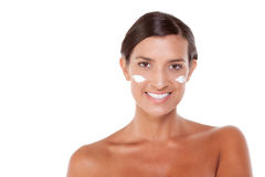 Skincare Young Caucasian woman. Young Caucasian woman putting cream on her face Stock Image