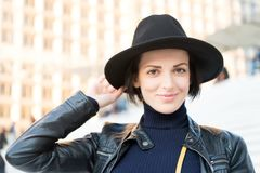 Skincare, youth, visage. Woman in black hat smile on stairs in paris, france, fashion. Beauty, look, makeup. Fashion, accessory, s. Skincare, youth, visage Royalty Free Stock Photography