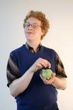 Skinflint mit piggy Querneigung Lizenzfreies Stockfoto