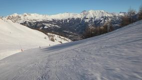 Skiing down a slope stock footage