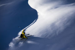Skiing virgin powder. Skiing in a virgin snow, feeling happiness and adrenaline royalty free stock photos
