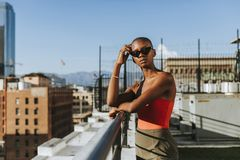 Skinhead girl at a LA rooftop stock image
