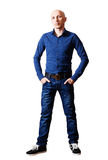 Skinhead man in shirt and blue jeans Stock Photo
