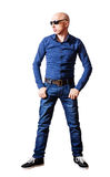 Skinhead man in sunglasses and blue jeans Stock Photo