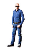 Skinhead man in sunglasses, shirt and blue jeans Royalty Free Stock Photos