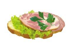 skinka smaklig isolerad smörgås arkivbild