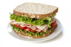 Skinksmörgås på vit Arkivfoton