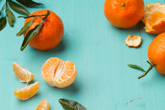 Skinless and fresh tangerines on a turquoise table Royalty Free Stock Photos
