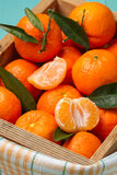 Skinless and fresh tangerines on a turquoise table Royalty Free Stock Photo