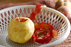 Skinless peel apple. In tray Royalty Free Stock Photo