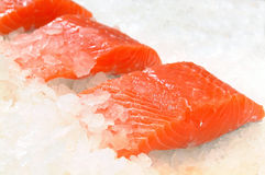 Skinless salmon fillet on ice Royalty Free Stock Photography