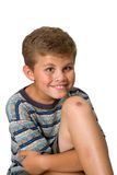 Skinned knee, big smile. Young boy with a scar on his knee and a big smile isolated on white Royalty Free Stock Photography