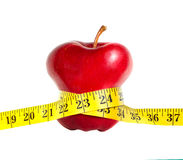 A skinny apple with a measuring tape Royalty Free Stock Image