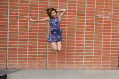 Skinny Asian American Woman Jumping In Dress Royalty Free Stock Photo