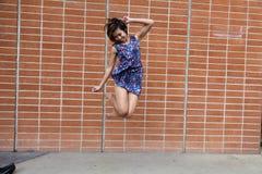 Skinny Asian American Woman Jumping In Dress Stock Image