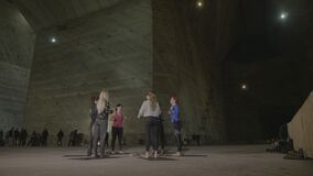Skinny attractive women warming up with aerobic exercises in a cold underground salt mine -. Skinny attractive women warming up with aerobic exercises in a cold stock video footage