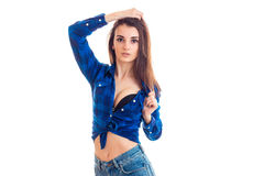 Skinny beautiful young girl in the blue shirt keeps hair hand Stock Photography