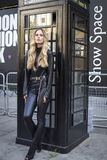 Skinny blonde in black leather trousers and denim jacket. LONDON, United Kingdom- SEPTEMBER 14 2018: People on the street during the London Fashion Week. Skinny royalty free stock images