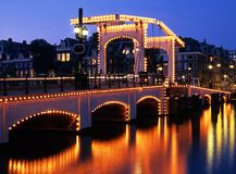 The Skinny Bridge, Amsterdam, Holland. The Skinny Bridge (Magere Brug) at night, Amsterdam, Holland, Netherlands, Europe stock images