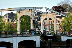 Skinny bridge or magere brug in Amsterdam crossing the amstel river. Is only allowed fot pedestrians and bicycles royalty free stock images