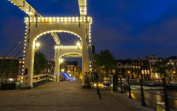The Skinny Bridge Magere Brug at night, Amsterdam, Holland, Europe. The Skinny Bridge Magere Brug at night, Amsterdam, Holland, Netherlands, Europe stock photo