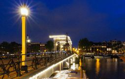 The Skinny Bridge Magere Brug at night, Amsterdam, Holland, Europe. The Skinny Bridge Magere Brug at night, Amsterdam, Holland, Netherlands, Europe stock photography