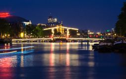The Skinny Bridge Magere Brug at night, Amsterdam, Holland, Europe. The Skinny Bridge Magere Brug at night, Amsterdam, Holland, Netherlands, Europe royalty free stock photography