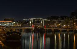 The skinny bridge magere brug at night amsterdam holland netherlands europe. The Magere Brug Skinny Bridge on the Amstel river in the Netherlands stock photo