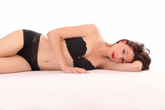 Skinny caucasian woman reclining Royalty Free Stock Photography