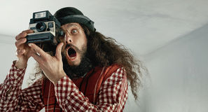 Skinny funny man taking a photograph Royalty Free Stock Photography