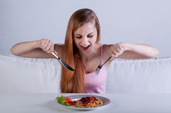 Skinny girl eat dinner Royalty Free Stock Photography