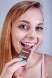 Skinny girl eats sweets Stock Photos