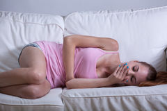Skinny girl feeling sick Stock Photos