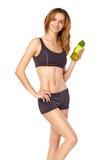 Skinny girl in sportswear holding water bottle Royalty Free Stock Photo