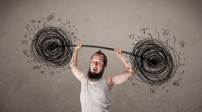 Skinny guy defeating chaos situation Royalty Free Stock Photo