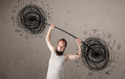 Skinny guy defeating chaos situation Royalty Free Stock Photos