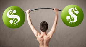 Skinny guy lifting green dollar sign weights Royalty Free Stock Photo