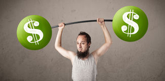 Skinny guy lifting green dollar sign weights Stock Images