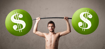 Skinny guy lifting green dollar sign weights Stock Photos