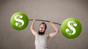 Skinny guy lifting green dollar sign weights. Funny skinny guy lifting green dollar sign weights royalty free stock photos