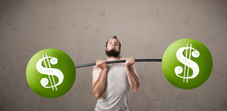Skinny guy lifting green dollar sign weights Stock Photo